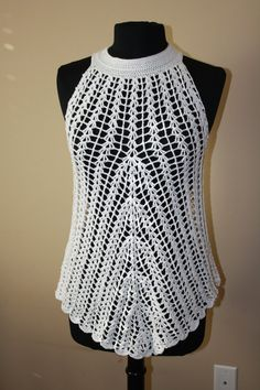 This beautiful crochet tunic is made out of high-quality yarn in white. This crochet tunic is stretchy and made to fit anyone size S to size M. Shown on my size 10 dress form. This crochet tunic has a 2 button closure on the back. Wash and dry on delicate cycle.  Made by hand in my pet-free and smoke-free studio. Check out my shop for other crochet creations.  Im currently taking custom orders. Message me with your requests.
