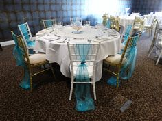 Wedding breakfast set up with pale blue organza sashes.  Want your own quote? Then email me with your ideas! hello@beckiemelvinevents.co.uk  More styles can be seen at www.beckiemelvinevents.co.uk