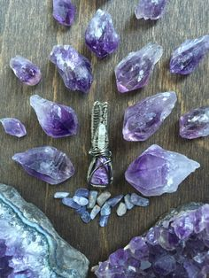 This small but powerful Charoite is paired with the cutest little Angel Aura Quartz Point and wrapped in both Gun Metal and Silver coated non tarnish