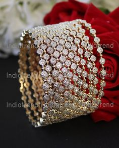 12 PC Bangle Set Studded with Simulated Diamonds. Bangle Size : or diameter Base : High Grade Alloy Metal Indian Bridal Jewelry Sets, Indian Jewelry Earrings, Bridal Bangles, Jewelry Design Earrings, Wedding Jewelry Sets, Egyptian Jewelry, Crystal Jewelry, Jewelry Art, Silver Jewelry