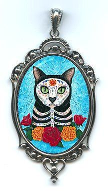 "So cool! Cat-themed Dia de los Muertos pendant. This would be perfect for our ""Cinco de Meow"" Furball this year!"
