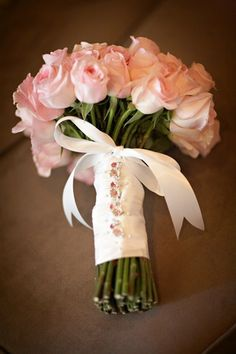 pink rose wedding bouquet. Add some color to flowers instead of pure white flowers. It photographs better.