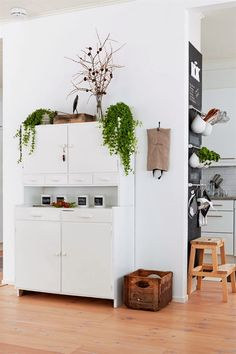 Add hanging storage: Look how much function this family squeezed out of this small wall. They hung horizontal racks (this looks like GRUNDTAL rails and hooks from IKEA) to hold herbs, utensils and towels. Kitchen Chalkboard, Cocinas Kitchen, Diy And Crafts Sewing, Hanging Storage, Wall Storage, Kitchen Storage, Apartment Kitchen, Scandinavian Style, Home Organization