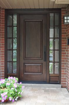 This stained woodgrain fiberglass door system gives a classic, traditional feel to this home.  www.doorwayinc.ca Burlington, ON #doors #burlington #doorway