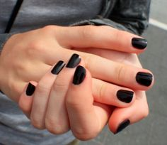 Ahh... if only I could get my nails to look that pretty, and stay like that. Black is such an eternal and powerful color. A great choice for your nails!