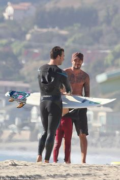 Got any good advice? Stood with Romeo, it appeared that David picking up tips from the fellow surf dude