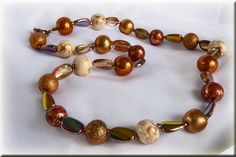 These are some of my coppery colour polymer clay beads with glass AB flay beads.