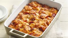 Grands!® Pepperoni Pizza Bake  can (16.3 oz) Pillsbury™ Grands!™ Homestyle refrigerated original biscuits  1 can (8 oz) pizza sauce 2 cups finely shredded mozzarella cheese (8 oz) 16 slices pepperoni (1 1/2 inch)