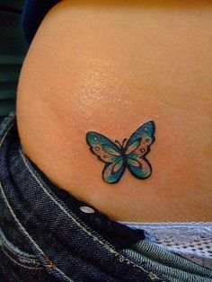 Cute butterfly tattoo design. Maybe in red for a monarch, with a couple blue stars around it.
