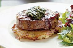 A satisfying meal of scotch fillet, barbecued and served with a golden potato cake and homemade basil pesto.