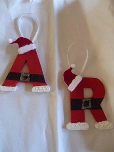 Santa Initial Ornaments--You can buy these wooden letters for cheap at any craft store.  Inexpensive ornaments to make.  The santa hats are stickers by Jolee's Boutique:  http://www.amazon.com/Jolees-Boutique-Dimensional-Stickers-Santa/dp/B001DXGQ42