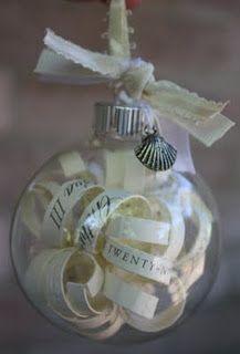 wedding invitation ornament: cut strips of leftover invites, curl around pencil, fill empty glass ornament