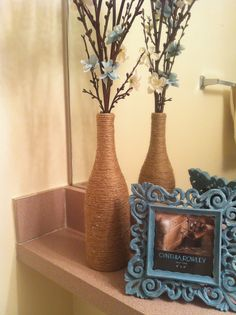 Wine bottle wrapped in jute. Now using it for a decorative vase.