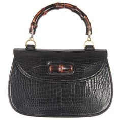 Preowned Gucci Vintage Black Crocodile Leather Bamboo Bag Top Handle... (£2,785) ❤ liked on Polyvore featuring bags, handbags, black, top handle bags, handbag purse, top handle handbags, man bag, gucci handbags and gucci purse