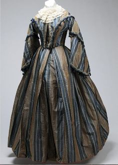 Woman's blue, brown and cream striped taffeta two-piece evening gown with close fitting bodice, pagoda sleeves, and full skirt. Ca. 1848 to 1858   Missouri History Museum #vintage #vintagefashion