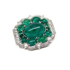 - Art Deco cabochon emerald and diamond cluster brooch by Cartier, Paris c.1935,