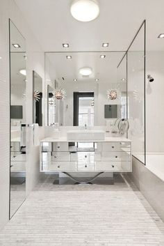 Contemporary Bathroom by Terrie Koles Design, llc is done in a style that recalls old-fashioned Hollywood glamour, complete with a custom mirrored vanity and Sputnik-style sconces.