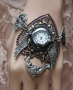 Steampunk Watch  Gothic jewelry  Bracelet cuff. $45.00, via Etsy.