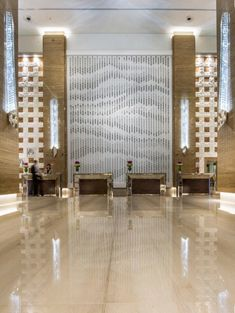 Kempinski Hotel Dubai - Mall of the Emirates. 'Drift', a sculptural artwork for the lobby of the Kempinski Hotel, Dubai by Giles Miller Studio. Thousands of boxes of varying depths are suspended in front of a wall and lit in such a way that they cast varying degrees of shadow on the wall behind.