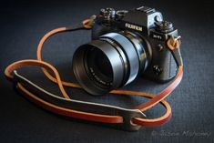 Fuji X-T1 camera with Gordy's horizontal neck strap in russet brown leather with black leather neck pad.