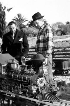 Salvador Dali and Walt Disney play with trains