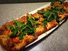 Back Tonight in Alices  Smoked Salmon Pizza $10  Crisp flat-bread topped with a lemon and dill cream sauce smoked salmon capers bacon smoked gouda and arugula.