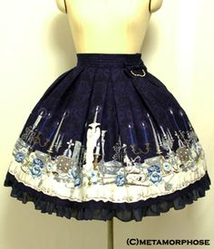 Dim Light Skirt    14800 YEN    product NO: 13023005 ■ ■ ■    fabric: original Dim Light print fabric (cotton 100%), de chine fabric, braid, dull satin ribbon, pearl beads    style: zipper on side, elastic back waist, lace-up back, detachable ribbon broach with pearl chain, comes with lining    size: length 55cm (21.6in) + frill 3cm, skirt length 50cm (19.6in) + frill 3cm, waist 64cm (25.1in)