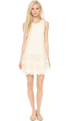 Ella Moss Hanalei Mini Dress Allover embroidery gives this Ella Moss dress a graceful, delicate look. Ruching lends volume to the skirt, and a buttoned keyhole closes the back. Tonal jersey lining.