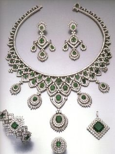 Parure of emeralds and diamonds, maybe the necklace forms into a tiara? I think so!