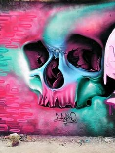 Pink and teal skull graffiti style