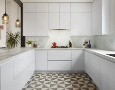 Angular patterned tiles would work best next to the angled wood floor