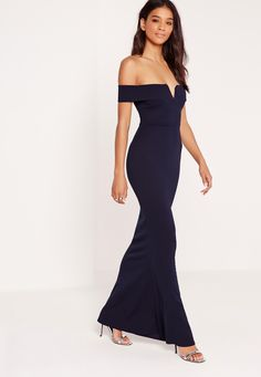 Max out your wardrobe and own the night in this babin' beaut! Featuring a navy blue hue, sweet bardot neckline, maxi length and a sexy v front, you'll be channelling maximum sexy vibes. Style with barely there heels and a matching clutch fo...