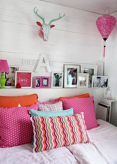 Colorful bedroom-love white rooms/white furniture/white bed spread w/ colorful pillows/frames/drapes and extra blankets
