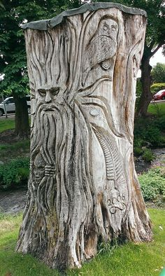 Tree sculpture with chain saw in Dollar, Central Scotland. Creating beauty and art from a tree stump, amazing