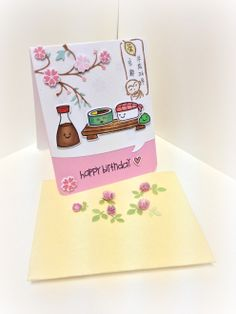 "For a birthday girl who is going to Kyoto for a 10 day meditation, so making this ""sushi under sakura (cherry blossom)"" card~ Hand made by Jodie Hui, Using: Let's roll , both stamp and die from Lawn Fawn; Honey blossom frame from Memory Box; Quotables Dies from Paper Smooches Stamps"