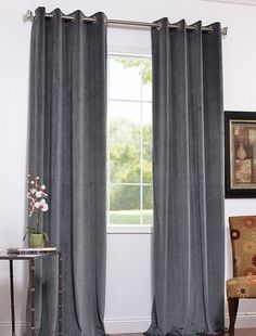 I like these grey curtains for the living room (& the curtain pole)