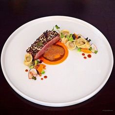 Brome lake duck breast, puff wild rice, wild goose confit totaling, carrots…