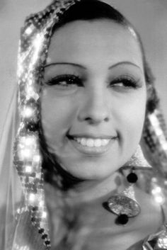 """JOSEPHINE BAKER: Born in 1906 into a very poor background and abused by a woman she worked for, she ended up living on the streets of St Louis at the age of 12. Here she learned to dance and was hired for the St. Louis Chorus vaudeville show at 15 before leaving for New York where she soon became known as """"the highest-paid chorus girl in vaudeville."""" in 1925 she danced in Paris at the 'Theatre des Champs Elysees', and became well known for her dancing, ending up at the Folies Bergeres."""