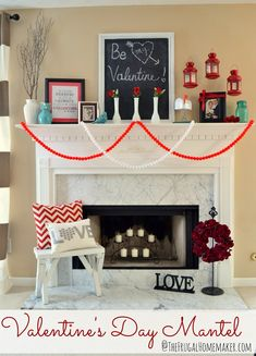 Valentine's Day Mantle...LOVE the pompom garland and the floating lanterns!