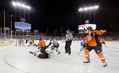 The Los Angeles Kings and the Anaheim Ducks compete during the first period. (Chris Carlson/AP)