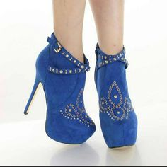Blue Faux Suede Studded Ankle Booties You will be head over heels for these saucy little numbers! They will perfectly compliment any outfit for any occasion! Make sure to add these to your collection, they definitely are a must have! The features for these booties include a faux suede upper with grommet and studded detailing, straps with buckle accents, stitched detailing, side zipper closure, stitched almond shaped closed toe, smooth lining, and cushioned footbed. Approximately 6 inch heels…