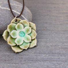 Yup...beautiful!  porcelain flower necklace by potteryandtile on Etsy, $28.00