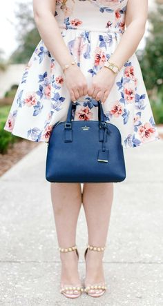 How to get Kate Spade and Tory Burch items for the lowest prices on @ebay + a preppy spring outfit idea with Orlando, Florida, fashion blogger Ashley Brooke Nicholas! #ebay #fillyourcartwithcolor #founditonebay #ad #katespade #toryburch | blush velvet pearl heels, Kate Spade sale, Tory Burch sale, Kate Spade Cameron Street Lottie Handbag, Kate Spade jewelry, bow watch, floral fit and flare dress, petite fashion, spring fashion, petite outfit ideas, church outfit idea, Easter outfit idea