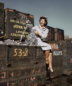 "Long Beach, California. October 1942. ""Annette del Sur publicizing salvage campaign in yard of Douglas Aircraft Company."" 4×5 Kodachrome transparency by Alfred Palmer for the Office of War Information. #WWII"