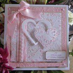 Embossing and inking, ribbons and pearls, this one is quite large at 10x10 with matching box.    Hello Peeps, hope you all all OK and y...