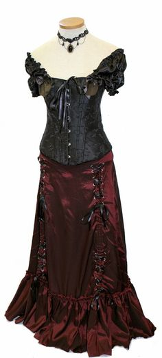 Our steel boned Mourning Belle corset is combined with the Burgundy Victorian Trinity skirt for a strikingly modern vicion of the past. The Victorian Trinity skirt can be worn three ways, giving you options! Set included the Black Amulet choker.  	Skirt is shown with the inner laces fully down. Scroll through the photos for other ways the skirt can be worn,  	PLEASE NOTE THE SIZE CHARTS BELOW. Corset and skirt each have their own size chart.  	   	CORSET SIZE CHART  	SKIRT SIZE CHART