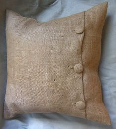 no sew pillow cover idea. Use iron on tape to seal edge. cut  slits for buttons and sew on covered buttons on reverse side