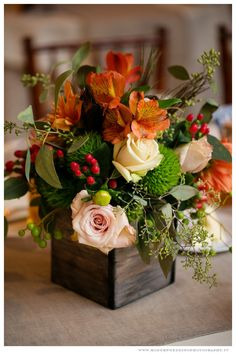 Wedding centerpiece- orange-reds-pink  www.ModernWeddingPhotography.tv  Flowers by Open House Country Flowers