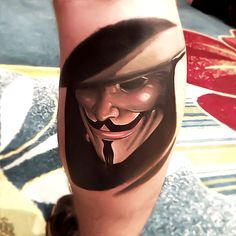 """my new V for Vendetta Tattoo :) (right calf) - it's the start of my V for Vendetta collage :D gonna be adding more images to it (mainly from the graphic novel) done by the kick arse Leifat Studio XIII (in Cocoa Beach, FL) """"Beneath this mask there is more than flesh. Beneath this mask there is an idea, Mr. Creedy, and ideas are bulletproof."""""""