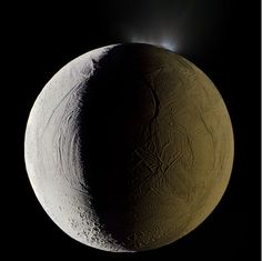 Enceladus, the sixth-largest moon of Saturn, seen shooting geysers water into space from its south polar region in this mosaic composite photograph. Photo by Michael Benson. (click through image for full article)